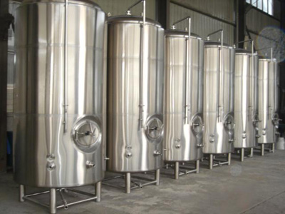 Vertical serving bright beer tanks isolated